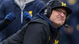 Should Jim Harbaugh accept a lifetime contract from the University of Michigan?