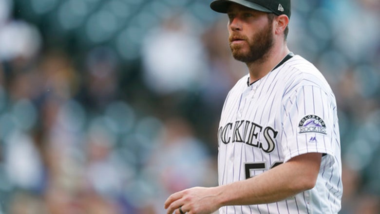 Holland declines $15M option with Rockies, goes free
