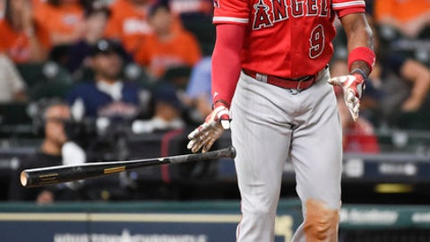 Los Angeles Angels' Justin Upton watches his solo home run off Houston Astros relief pitcher Luke Gregerson during the eighth inning of a baseball game, Sunday, Sept. 24, 2017, in Houston. (AP Photo/Eric Christian Smith)
