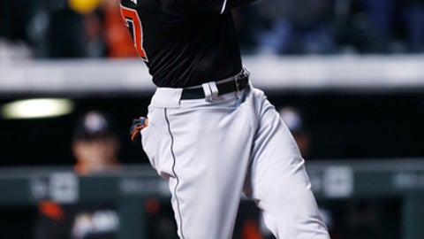 Miami Marlins' Giancarlo Stanton hits a double off Colorado Rockies relief pitcher Mike Dunn during the ninth inning of a baseball game Tuesday, Sept. 27, 2017, in Denver. The Rockies won 6-0. (AP Photo/David Zalubowski)