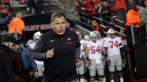 Former Rutgers football head coach, now Ohio State associate head coach/defensive coordinator, Greg Schiano runs onto the field before an NCAA college football game against Rutgers, Saturday, Sept. 30, 2017, in Piscataway, N.J. (AP Photo/Mel Evans)