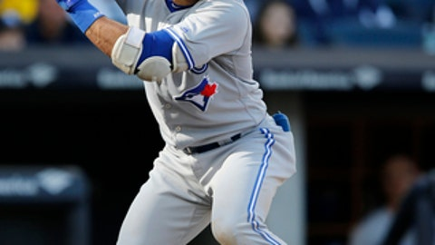 Toronto Blue Jays designated hitter Jose Bautista sets up during the fourth inning of a baseball game against the New York Yankees in New York, Sunday, Oct. 1, 2017. (AP Photo/Kathy Willens)