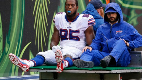 Buffalo Bills tight end Charles Clay (85) is carted off the field in the first half of an NFL football game against the Cincinnati Bengals, Sunday, Oct. 8, 2017, in Cincinnati. (AP Photo/Gary Landers)