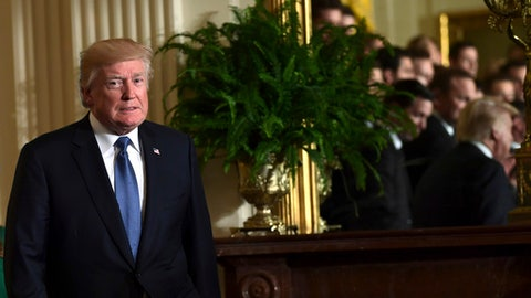 President Donald Trump arrives for a ceremony to honor the 2017 NHL Stanley Cup Champion Pittsburgh Penguins, Tuesday, Oct. 10, 2017, in the East Room of the White House in Washington. (AP Photo/Susan Walsh)