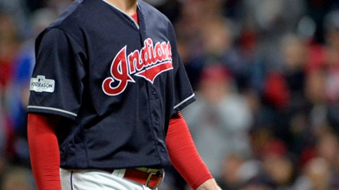 Cleveland Indians starting pitcher Corey Kluber walks to the dugout in the fourth inning of Game 5 against the New York Yankees in a baseball American League Division Series, Wednesday, Oct. 11, 2017, in Cleveland. Kluber pitched 3 2/3 innings and gave up three hits and three runs. (AP Photo/Phil Long)