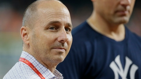 New York Yankees general manager Brian Cashman watches batting practice before Game 2 of baseball's American League Championship Series against the Houston Astros Saturday, Oct. 14, 2017, in Houston. (AP Photo/Tony Gutierrez)