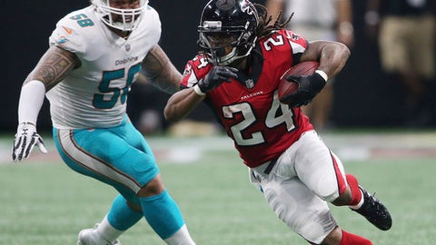 Atlanta Falcons running back Devonta Freeman (24) runs past Miami Dolphins outside linebacker Rey Maualuga (58) during the second half of an NFL football game, Sunday, Oct. 15, 2017, in Atlanta. (AP Photo/John Bazemore)