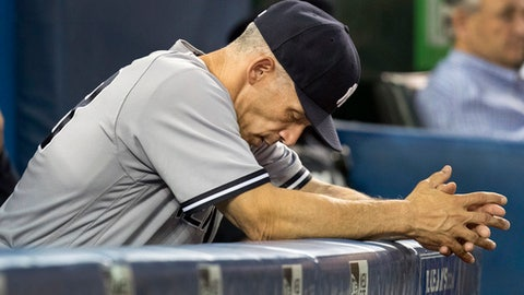 FILE - In this Aug. 8, 2017, file photo, New York Yankees manager Joe Girardi reacts during the sixth inning of their baseball game against the Toronto Blue Jays, in Toronto. The New York Yankees announced Thursday, Oct. 26, 2017, that Girardi will not return to the team in the 2018 season. The announcement was made by Yankees Senior Vice President and General Manager Brian Cashman. (Fred Thornhill/The Canadian Press via AP)