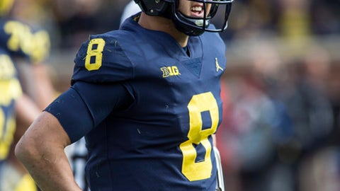 Michigan quarterback John O'Korn (8) reacts after fumbling a snap and taking a sack in the first quarter of an NCAA college football game against Rutgers in Ann Arbor, Mich., Saturday, Oct. 28, 2017. (AP Photo/Tony Ding)