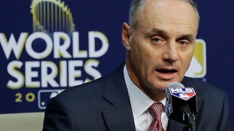 Baseball Commissioner Rob Manfred answers questions at a news conference before Game 4 of baseball's World Series between the Houston Astros and the Los Angeles Dodgers Saturday, Oct. 28, 2017, in Houston. Manfred announced that Houston Astros' Yuli Gurriel will be suspended five games without pay starting in the 2018 season. (AP Photo/David J. Phillip)