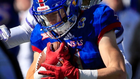 Kansas wide receiver Tyler Patrick (4) is tackled by Kansas State defensive back AJ Parker, back, during the first half of an NCAA college football game in Lawrence, Kan., Saturday, Oct. 28, 2017. (AP Photo/Orlin Wagner)