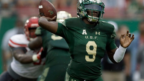 South Florida quarterback Quinton Flowers (9) throws a pass against Houston during the second half of an NCAA college football game Saturday, Oct. 28, 2017, in Tampa, Fla. Houston upset South Florida 28-24. (AP Photo/Chris O'Meara)