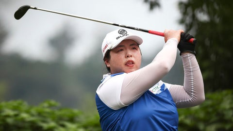 Shanshan Feng of China tees off at 14th hole during the final round of the Sime Darby LPGA golf tournament at Tournament Players Club (TPC) in Kuala Lumpur, Malaysia, Sunday, Oct. 29, 2017. (AP Photo/Sadiq Asyraf)