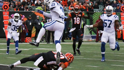 Cincinnati Bengals defensive end Michael Johnson, bottom, catches a touchdown pass against Indianapolis Colts cornerback Vontae Davis (21) in the second half of an NFL football game, Sunday, Oct. 29, 2017, in Cincinnati. (AP Photo/Gary Landers)