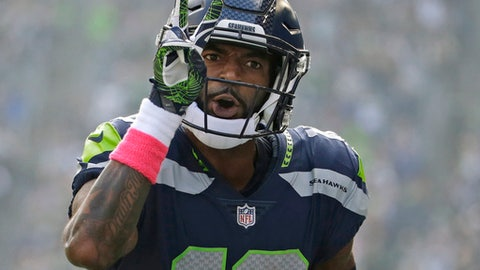Seattle Seahawks wide receiver Paul Richardson celebrates in the first half of an NFL football game after score his second touchdown against the Houston Texans, Sunday, Oct. 29, 2017, in Seattle. (AP Photo/Elaine Thompson)
