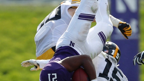 FILE - In this Oct. 21, 2017, file photo, Northwestern's Justin Jackson, left, is upended by Iowa's Joshua Jackson during the second half of an NCAA college football game, in Evanston, Ill. In his first season as a starter, Iowa's Joshua Jackson leads the nation in passes defended, averaging 2.13 per game. That includes two interceptions and 15 passes broken up. (AP Photo/Jim Young, File)