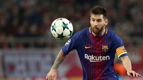 Barcelona's Lionel Messi controls the ball during the Champions League group D soccer match between Olympiakos and Barcelona at Georgios Karaiskakis stadium at Piraeus port, near Athens, Tuesday, Oct. 31, 2017. (AP Photo/Petros Giannakouris)