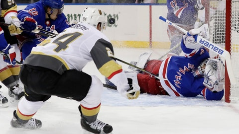 Vegas Golden Knights' Oscar Lindberg (24) shoots the puck past New York Rangers goalie Henrik Lundqvist (30) for a goal during the first period of an NHL hockey game Tuesday, Oct. 31, 2017, in New York. (AP Photo/Frank Franklin II)