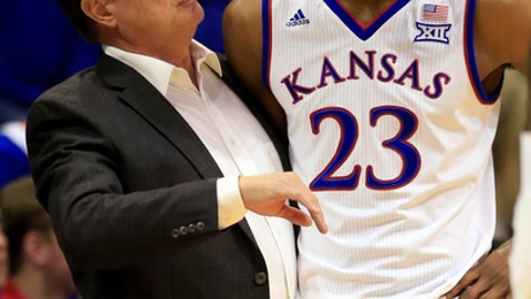 Kansas head coach Bill Self, left, talks with Kansas forward Billy Preston (23) during the first half of an exhibition NCAA college basketball game against Pittsburg State in Lawrence, Kan., Tuesday, Oct. 31, 2017. (AP Photo/Orlin Wagner)