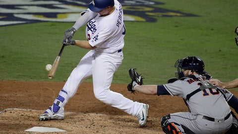 Los Angeles Dodgers' Joc Pederson hits a home run against the Houston Astros during the seventh inning of Game 6 of baseball's World Series Tuesday, Oct. 31, 2017, in Los Angeles. (AP Photo/Jae C. Hong)