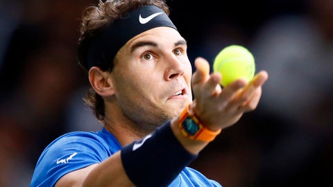 Rafael Nadal of Spain serves the ball to Hyeon Chung of South Korea during the Paris Masters tennis tournament at the Bercy Arena in Paris, France, Wednesday, Nov. 1, 2017. (AP Photo/Francois Mori)