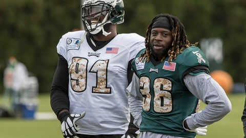 Philadelphia Eagles defensive tackle Fletcher Cox (91) has a laugh with newly acquired Eagles running back Jay Ajayi during his first practice with the Eagles, Wednesday, Nov. 1, 2017 in Philadelphia. Ajayi was acquired in a trade with the Miami Dolphins. (Clem Murray/The Philadelphia Inquirer via AP)