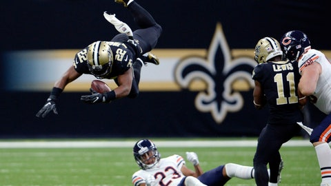 FILE - In this Sunday, Oct. 29, 2017, file photo, New Orleans Saints running back Mark Ingram (22) regains control of the ball as he leaps over Chicago Bears cornerback Kyle Fuller (23) in the first half of an NFL football game in New Orleans. While Mark Ingram has played a central role in the Saints' five-game winning streak, coach Sean Payton was clearly concerned by his late-game fumbles last weekend. As New Orleans prepares to host Tampa Bay, Ingram is trying to regain the trust of teammates and coaches. (AP Photo/Bill Feig, File)
