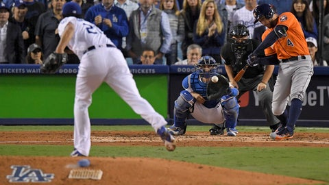 Houston Astros' George Springer, right, hits a two-run home run off Los Angeles Dodgers starting pitcher Yu Darvish, of Japan, during the second inning of Game 7 of baseball's World Series Wednesday, Nov. 1, 2017, in Los Angeles. (AP Photo/Mark J. Terrill)