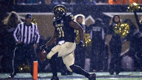 Western Michigan running back Jarvion Franklin runs into the end zone for a touchdown during the first half of an NCAA college football game against Central Michigan, Wednesday, Nov. 1, 2017, in Kalamazoo, Mich. (AP Photo/Carlos Osorio)