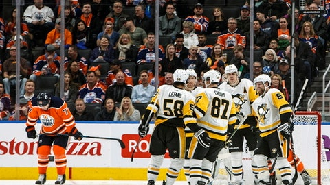 Pittsburgh Penguins players celebrate a goal as Edmonton Oilers' Oscar Klefbom (77) reacts during the second period of an NHL hockey game in Edmonton, Alberta, Wednesday, Nov. 1, 2017. (Jason Franson/The Canadian Press via AP)