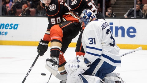 Anaheim Ducks center Antoine Vermette, left, screens Toronto Maple Leafs goalie Frederik Andersen during the second period of an NHL hockey game Wednesday, Nov. 1, 2017, in Anaheim, Calif. (AP Photo/Kyusung Gong)