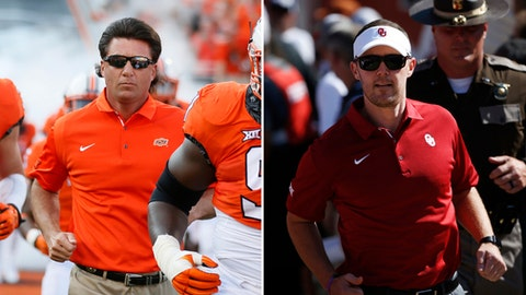FILE - At left, in an Aug. 31, 2017, file photo, Oklahoma State head coach Mike Gundy runs onto the field before an NCAA college football game against Tulsa, in Stillwater, Okla. At right, in an Oct. 14, 2017, file photo, Oklahoma head coach Lincoln Riley takes the field before playing Texas in an NCAA college football game, in Dallas. For only the second time in 13 years, No. 8 Oklahoma (7-1, 4-1 Big 12) and No. 11 Oklahoma State (7-1, 4-1) are meeting before the final game of the regular season. The Sooners and the Cowboys are part of a four-way tie atop the conference standings with four games left before the league's championship game. There is the possibility they could meet again Dec. 2, no matter who wins Saturday in Stillwater. (AP Photo/File)