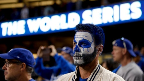 Los Angeles Dodgers fans watch as the Houston Astros celebrate their win in Game 7 of baseball's World Series Wednesday, Nov. 1, 2017, in Los Angeles. The Astros won 5-1 to win the series 4-3. (AP Photo/Jae C. Hong)