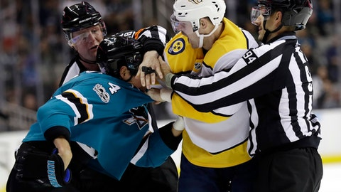 Nashville Predators' Austin Watson, second from right, fights with Brenden Dillon (4) during the third period of an NHL hockey game Wednesday, Nov. 1, 2017, in San Jose , Calif. (AP Photo/Marcio Jose Sanchez)