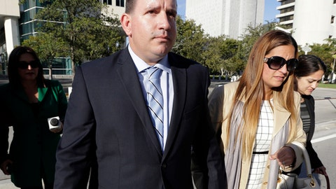 FILE - In this Feb. 1, 2017, file photo, baseball trainer Julio Estrada, left, leaves federal court in Miami. Sports agent Bartolo Hernandez and Estrada are facing prison time at a sentencing hearing in Miami after their convictions for illegally smuggling Cuban players into the U.S. Court documents show prosecutors will ask a judge Thursday, Nov. 2, to exceed the nine-year maximum sentences recommended by federal guideline. Attorneys for both men are seeking more lenient prison terms. (AP Photo/Lynne Sladky, File)