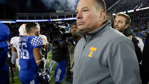 FILE - In this Saturday, Oct. 28, 2017, file photo, Tennessee head coach Butch Jones walks on the field after his team was lost 29-26 to Kentucky in an NCAA college football game in Lexington, Ky. Florida became the first Power Five program this season to make a coaching, but several more enter the last month of the season faced with what could be a hard choice. Tennessee has record of 3-5. (AP Photo/David Stephenson, File)