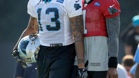 FILE - In this Aug. 3, 2017, file photo, Carolina Panthers' Cam Newton (1) talks with Kelvin Benjamin (13) during practice at the NFL team's football training camp at Wofford College in Spartanburg, S.C. The Panthers never informed quarterback Cam Newton they planned to trade away his No. 1 receiver and closest friend on the team before making the move.  Newton found out about the Kelvin Benjamin trade about the same time people did _ on social media.  (AP Photo/Chuck Burton, File)