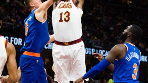 CLEVELAND, OH - OCTOBER 29: Kristaps Porzingis fouls Tristan Thompson #13 of the Cleveland Cavaliers during the second half at Quicken Loans Arena on October 29, 2017 in Cleveland, Ohio. The Knicks defeated the Cavaliers 114-95. NOTE TO USER: User expressly acknowledges and agrees that, by downloading and/or using this photograph, user is consenting to the terms and conditions of the Getty Images License Agreement. (Photo by Jason Miller/Getty Images)