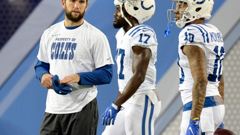 FILE - In this Oct. 16, 2017, file photo, injured Indianapolis Colts quarterback Andrew Luck watches as teammates warm up before an NFL football game against the Tennessee Titans in Nashville, Tenn. The Colts will place Luck on the season-ending injured reserve list. (AP Photo/Mark Zaleski, File)