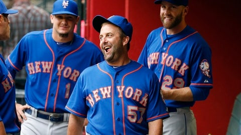 FILE - In this June 4, 2015, file photo, New York Mets hitting coach Kevin Long (57) jokes with Darrell Ceciliani (1) and Eric Campbell (29) in the dugout prior to a baseball game against the Arizona Diamondbacks in Phoenix. A person with knowledge of the deal tells The Associated Press that the Washington Nationals have agreed to hire Kevin Long as their new hitting coach. The person spoke on condition of anonymity on Thursday, Nov. 2, 2017, because the Nationals have not made any announcements about their new coaching staff. Long replaces Rick Schu as Washington's hitting coach. (AP Photo/Ross D. Franklin, File)
