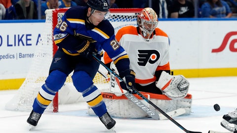 St. Louis Blues' Paul Stastny (26) watches the puck sail past Philadelphia Flyers goalie Michal Neuvirth, of the Czech Republic, during the second period of an NHL hockey game Thursday, Nov. 2, 2017, in St. Louis. (AP Photo/Jeff Roberson)