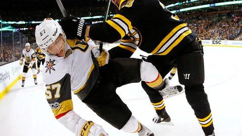 Boston Bruins defenseman Zdeno Chara, right, checks Vegas Golden Knights' David Perron (57) during the third period of an NHL hockey game in Boston, Thursday, Nov. 2, 2017. (AP Photo/Winslow Townson)