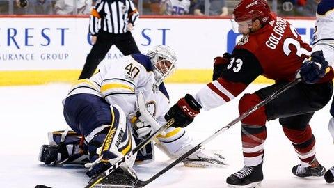 Buffalo Sabres goalie Robin Lehner (40) kicks the puck away from Arizona Coyotes defenseman Alex Goligoski (33) during the second period of an NHL hockey game Thursday, Nov. 2, 2017, in Glendale, Ariz. (AP Photo/Ross D. Franklin)