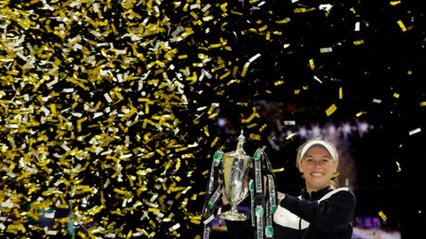 In this Sunday, Oct. 29, 2017, file photo, Caroline Wozniacki of Denmark lifts the winner's trophy after winning the singles final match against Venus Williams of the United States, at the WTA tennis tournament in Singapore. (AP Photo/Yong Teck Lim, File)
