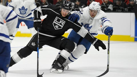 Los Angeles Kings left wing Adrian Kempe, left, of Sweden, vies for the puck with Toronto Maple Leafs defenseman Nikita Zaitsev, of Russia, during the second period of an NHL hockey game, Thursday, Nov. 2, 2017, in Los Angeles. (AP Photo/Mark J. Terrill)