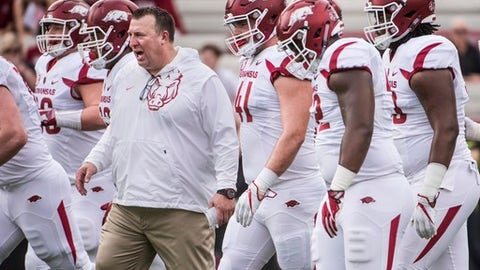 FILE - In this Oct. 7, 2017, file photo, Arkansas coach Bret Bielema joins his team on the field before an NCAA college football game against South Carolina in Columbia, S.C. Bielema knows the path to a bowl game likely requires Arkansas to win at least three of its last four games to end the regular season. The Razorbacks coach just isn't ready to look that far ahead, not in a season full of disappointing blowout losses, numerous season-ending injuries to top players and growing fan frustration. Arkansas (3-5) is expected to take a step toward keeping its remote bowl hopes alive when it hosts struggling Coastal Carolina (0-7) on Saturday. (AP Photo/Sean Rayford, File)