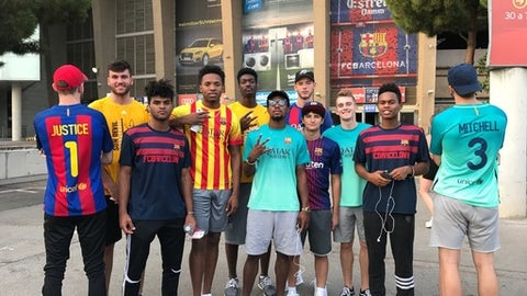 In this image taken Aug. 7, 2017, and provided by Arizona State University, members of Arizona State's men's basketball team pose outside of FC Barcelona's  Camp Nou stadium in Barcelona, Spain. College basketball teams are allowed foreign trips once every four years and the Sun Devils went to Rome and Barcelona during a nine-day trip. (Arizona State University via AP)