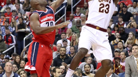 WASHINGTON, DC - NOVEMBER 3: LeBron James #23 of the Cleveland Cavaliers puts up a shot over Jodie Meeks #20 of the Washington Wizards in the first half at Capital One Arena on November 3, 2017 in Washington, DC. NOTE TO USER: User expressly acknowledges and agrees that, by downloading and or using this photograph, User is consenting to the terms and conditions of the Getty Images License Agreement. (Photo by Rob Carr/Getty Images)