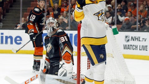 Nashville Predators left wing Scott Hartnell, right, celebrates after scoring against Anaheim Ducks goalie John Gibson, center, with right wing Corey Perry, left, watching during the first period of an NHL hockey game in Anaheim, Calif., Friday, Nov. 3, 2017. (AP Photo/Alex Gallardo)