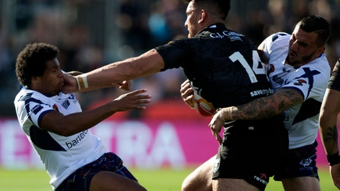 New Zealand's Nelson Asofa-Solomona fends off Scotland's Oscar Thomas, left, during their Rugby League World Cup game in Christchurch, New Zealand, Saturday, Nov. 4, 2017. (AP Photo/Mark Baker)